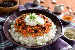 Chili con carne. Mexican food chili con carne on a wooden background stock images