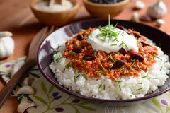 Chili con carne. Mexican food chili con carne on a wooden background royalty free stock images