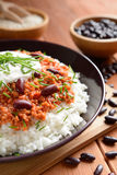 Chili con carne. Mexican food chili con carne on a wooden background royalty free stock photography