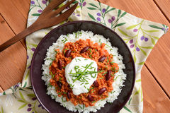 Chili con carne. Mexican food chili con carne on a wooden background stock photography