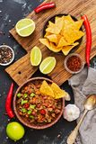 Chili con carne with nachos with meat and chips on rustic background. Mexican dish, top view royalty free stock images