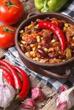 Chili con carne in a pot and ingredients. vertical stock image
