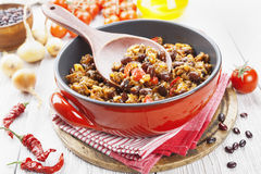 Chili con carne. In the pot on a wooden table stock photo