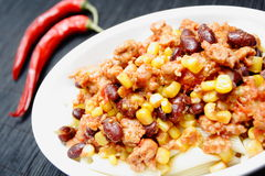 Chili con carne and red peppers Royalty Free Stock Photography