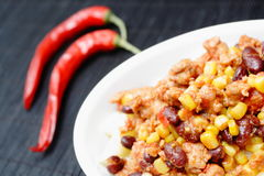 Chili con carne and red peppers close up Royalty Free Stock Image