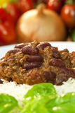Chili Con Carne On Rice With Basil Garnish Stock Photography