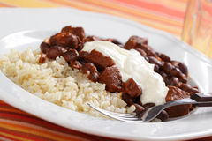 Chili con carne with rice and sour cream Stock Image
