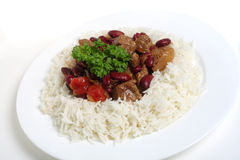 Chili con carne on rice, white background