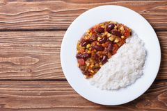 Chili con carne and rice on a white plate top view Stock Images