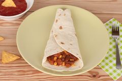Chili Con Carne on tortilla wrap with salsa sauce and tortilla c