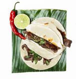 Chili con carne in wheat tortillas on banana leaf Stock Photos