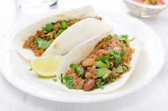 Chili con carne in wheat tortillas on a plate Stock Images