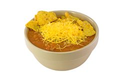 Chili and Corn Chips. Bowl of chili con carne with grated cheese and corn chips, isolated Royalty Free Stock Image