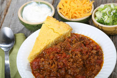 Chili with cornbread and fixings Royalty Free Stock Images