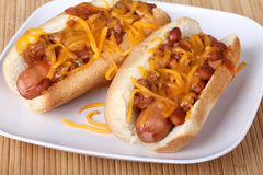 Chili Dogs. Two hot dogs on a bun covered with chili and melted shredded cheese Stock Photography