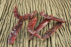 Chili. Dried red peppers on old wooden surface brown Royalty Free Stock Photos