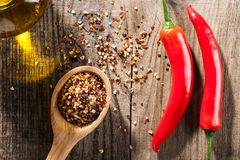 Red Chili peppers and exotic spices on wooden background Stock Image