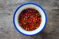 Chili in fish sauce with spoon stock photography