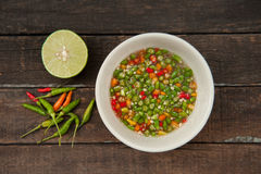 Chili and fish sauce. Chili and fish sauce , thai food, on wood table Royalty Free Stock Photos