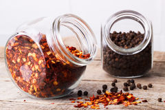 Chili flakes and black pepper Royalty Free Stock Photo