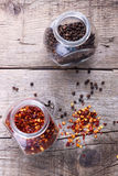 Chili flakes and black pepper Royalty Free Stock Image