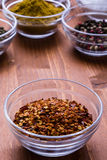 Chili flakes in a glass bowl stock image