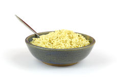 Chili flavored noodles in bowl with spoon Stock Image