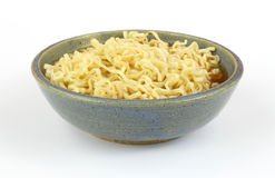 Chili flavored noodles in stoneware bowl Stock Image
