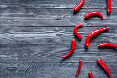 Chili food with red pepper on dark background top view mockup. Chili food with red pepper on dark wooden table background top view mockup Royalty Free Stock Photos