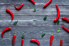 Chili food with red pepper on dark background top view mockup. Chili food with red pepper on dark wooden table background top view mockup Royalty Free Stock Photography