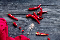 Chili food with red pepper on dark background top view. Chili food with red pepper on dark wooden table background top view Stock Photo