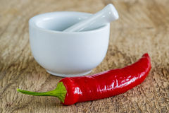Chili fruit with mortar Royalty Free Stock Images