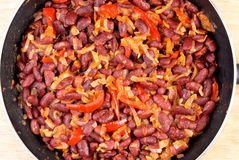 Chili in a frying pan Stock Photos