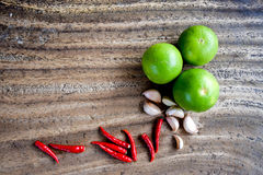 Chili, garlic and lime on wooden table, Asian herb and spicy royalty free stock photos