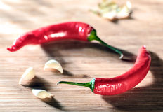 Chili and garlic on a table Stock Photo