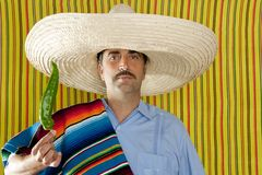 Chili hot pepper Mexican man typical poncho serape Stock Image