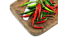 Chili, knives and old cutting boards Stock Photos