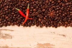 Chili, met koffiebonen op een lichte achtergrond Royalty-vrije Stock Afbeeldingen