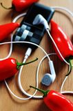 Chili and music player Royalty Free Stock Photography