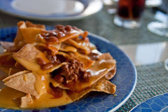 Chili Nachos on Blue Plate Stock Images