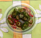 Chili Oil. Some olive oil with red and green chili peppers Stock Images