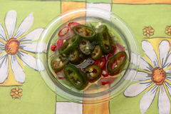 Chili Oil. Some olive oil with red and green chili peppers Royalty Free Stock Photo