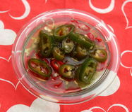 Chili Oil. Some olive oil with red and green chili peppers Stock Photography