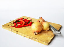 Chili and onion with kitchen tools on white background Royalty Free Stock Photos