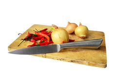 Chili and onion with kitchen tools on white background Royalty Free Stock Photography