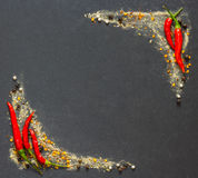 Chili, peper and spices  black stone with copyspace Stock Image