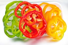 Chili pepper. Green red and yellow chili pepper bell slice rings  in stack arrangement Royalty Free Stock Photography