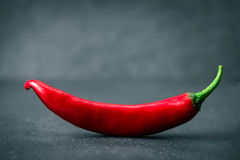 Chili pepper on black stone background , smiling shape Stock Photography