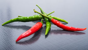 Chili pepper on a black texture Royalty Free Stock Photo
