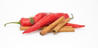 Chili pepper and cinnamon sticks. On white background Stock Photo